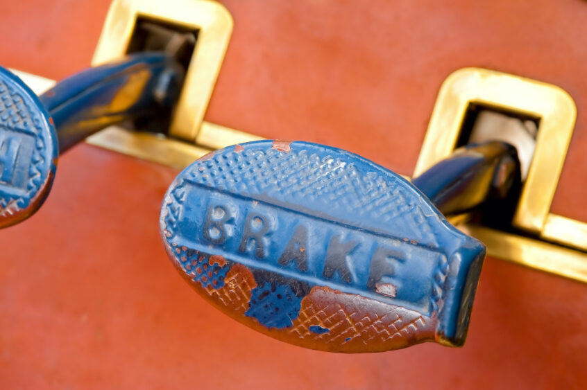 A close-up of an old car's brake pedal.
